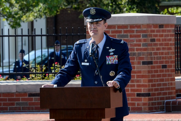Col. John Howard, 375th Air Mobility Wing commander, gives his first speech as the commander during the 375th AMW change of command ceremony July 24, 2017. Howard thanked those who have helped in throughout his Air Force career and spoke on maintaining the success of the 375th AMW.(U.S. Air Force photo by Airman Chad Gorecki)