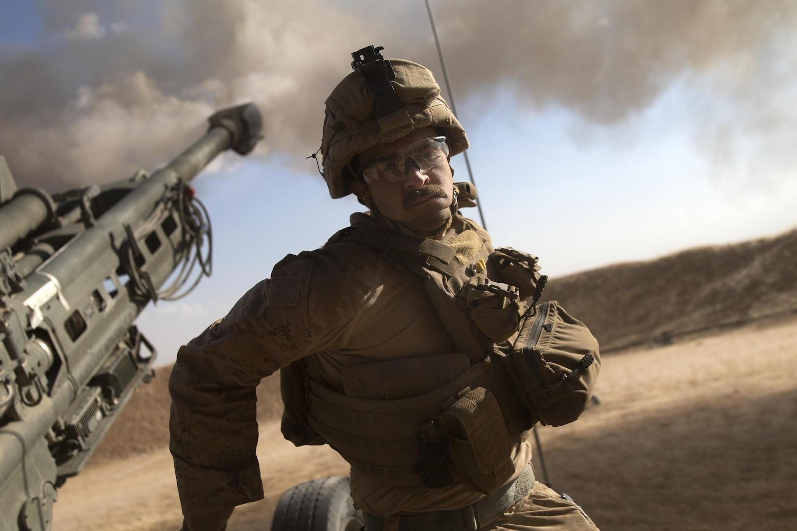 A U.S. Marine fires an M777-A2 Howitzer in Syria, June 1, 2017. The Marines had been conducting 24-hour all-weather fire support for the coalition's local partners, the Syrian Democratic Forces, as part of Combined Joint Task Force Operation Inherent Resolve. Marine Corps photo by Sgt. Matthew Callahan