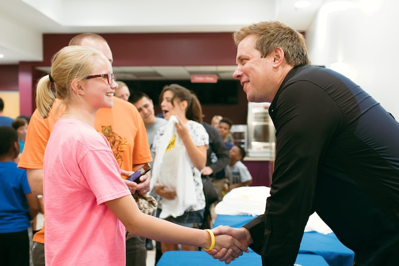 "Mike Super shakes hands with an audience member during a meet and greet at Joint Base Andrews, Md., July 21, 2017. Super was a finalist on NBC-TV's ""America's Got Talent"" in 2014 and earned the International Magician's Society Performing Arts Entertainer of the Year Award in 2011 and 2012. (U.S. Air Force photo by Senior Airman Delano Scott)"