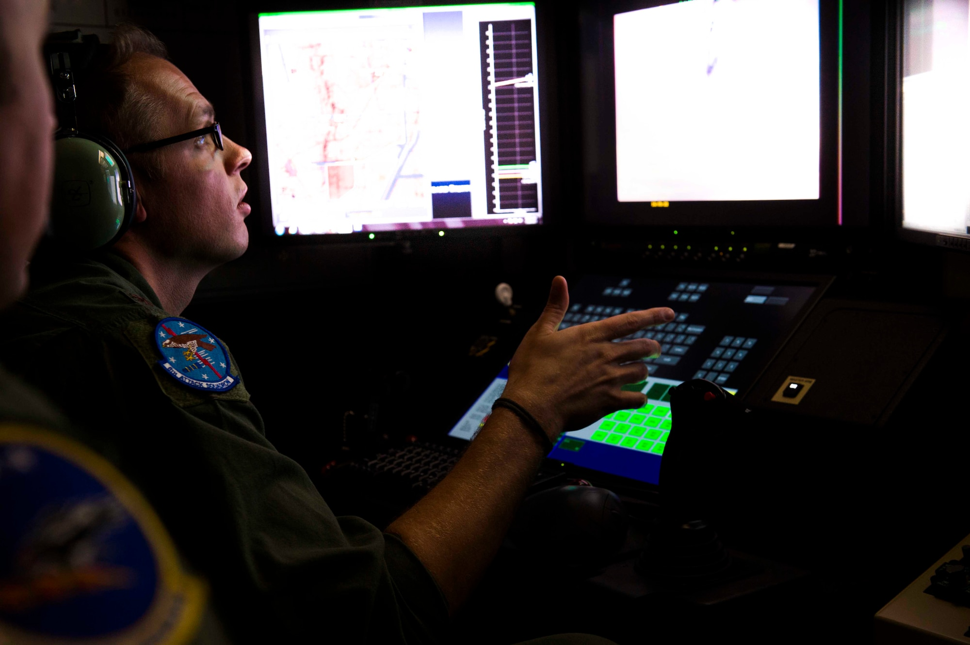 Maj. Jay, MQ-9 pilot with the 6th Attack Squadron, pilots the squadron's first Block 5 MQ-9 Reaper from inside a new Block 30 ground control station at Holloman Air Force Base, N.M., July 10, 2017. Holloman started flying the new Block 5 and Block 30 technology to ease the transition that student pilots and sensor operators will experience when joining a combat unit. (U.S. Air Force photo by Senior Airman Chase Cannon)