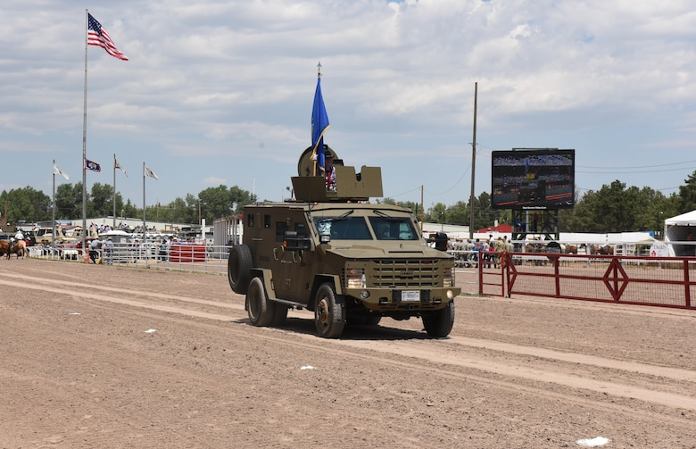 The Air Force flag was carried on a Bearcat vehicle during Military Monday at Frontier Park in Cheyenne, Wyo., July 24, 2017. Each branch of the military was represented by a service member carrying their respective flag in a motorcade procession. This year marks the 150th anniversary of F.E. Warren Air Force Base and the city of Cheyenne. The two communities came together to celebrate during the 121st Cheyenne Frontier Days rodeo and festival. (U.S. Air Force photo by Airman 1st Class Breanna Carter)