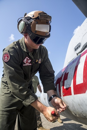 U.S. Marine Corps Cpl. Cole Moore, a powerline mechanic with Marine Fighter Attack Squadron (VMFA) 232, secures storage on an F/A-18C Hornet at JASDF Hyakuri Air Base, Japan, July 24, 2017. Maintenance keeps aircraft in a constant state of preparedness to enhance operational readiness and mission accomplishment. This is the first time that VMFA-232 has been to JASDF Hyakuri Air Base, which gave the local Japanese forces the ability to simulate air-to-air maneuvers with dissimilar aircraft. (U.S. Marine Corps photo by Lance Cpl. Mason Roy)