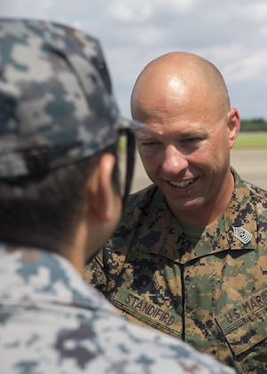 U.S. Marine Corps Sgt. Maj. Joseph Standifird, sergeant major of Marine Fighter Attack Squadron (VMFA) 232, bids farewell to a Japan Air Self-Defense Force (JASDF) service member at JASDF Hyakuri Air Base, Japan, July 21, 2017. The squadron conducted training to enhance proficiency in dissimilar basic fighter section-engaged maneuvers, active air defense and air interdictions, as well as fighter-attack instructor work-ups, and weapons and tactics instructor prerequisites. VMFA-232 hopes to work with Japanese forces in the future in order to foster host-nation partnerships, which in turn forms a more capable alliance.  (U.S. Marine Corps photo by Lance Cpl. Mason Roy)