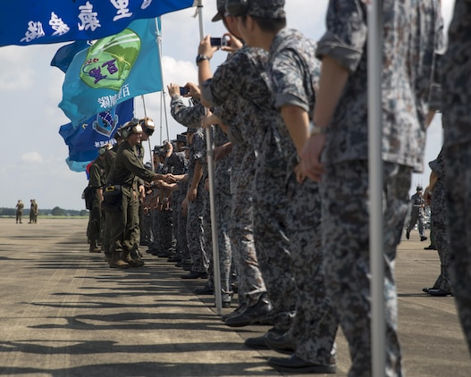 U.S. Marines with Marine Fighter Attack Squadron (VMFA) 232, say farewell to Japan Air Self-Defense Force (JASDF) service members at JASDF Hyakuri Air Base, Japan, July 24, 2017. VMFA-232 conducted exercises with the JASDF as part of the Aviation Training Relocation program, which is designed to increase operational readiness and interoperability between U.S. and Japanese forces, and to reduce the overall noise impact across Japan by dispersing bilateral jet-fighter training of U.S. forces across a multitude of different JASDF bases. (U.S. Marine Corps photo by Lance Cpl. Mason Roy)