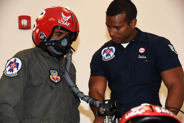 Staff Sgt. Kyle Boddie, U.S. Air Force Thunderbirds aircrew flight equipment technician, tests Juan Alonzo's breathing in a flight helmet before his flight July 24, 2017, on the Wyoming Air National Guard Base, Cheyenne, Wyo. The pilot and occupant are given a safety brief before the flight to ensure they are prepared for flight and can handle an in-flight emergency. (U.S. Air Force photo by 2d Lt. Nikita Thorpe)
