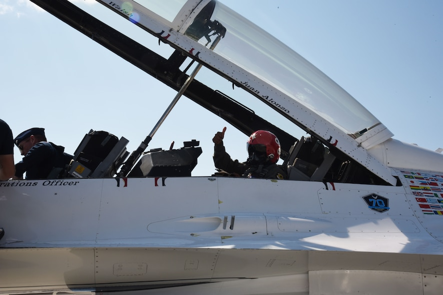 Juan Alonzo gives a thumbs-up from the U.S. Air Force Thunderbirds F-16 Fighting Falcon fighter aircraft before his flight July 24, 2017, on the Wyoming Air National Guard Base, Cheyenne, Wyo. Alonzo is a U.S. Army veteran and Championship Bull Rider competing in the World Finals during the 2017 Cheyenne Frontier Days. (U.S. Air Force photo by 2d Lt. Nikita Thorpe)