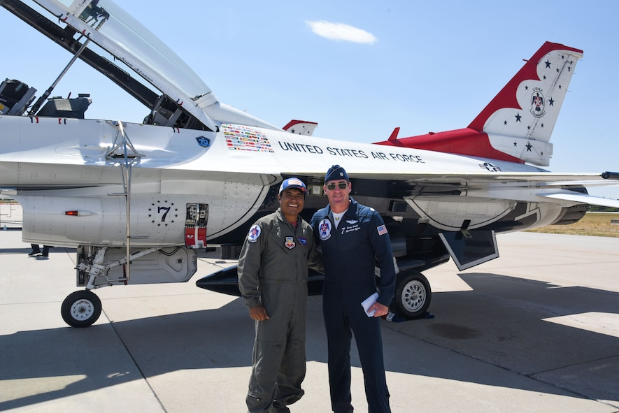 Juan Alonzo and Lt. Col. Kevin Walsh, U.S. Air Force Thunderbirds #7 pilot, pose in front of an F-16 Fighting Falcon after a successful celebrity flight July 24, 2017, at the Wyoming Air National Guard Base, Cheyenne, Wyo. Alonzo is a U.S. Army veteran and Championship Bull Rider competing in the World Finals during the 2017 Cheyenne Frontier Days. (U.S. Air Force photo by 2d Lt. Nikita Thorpe)