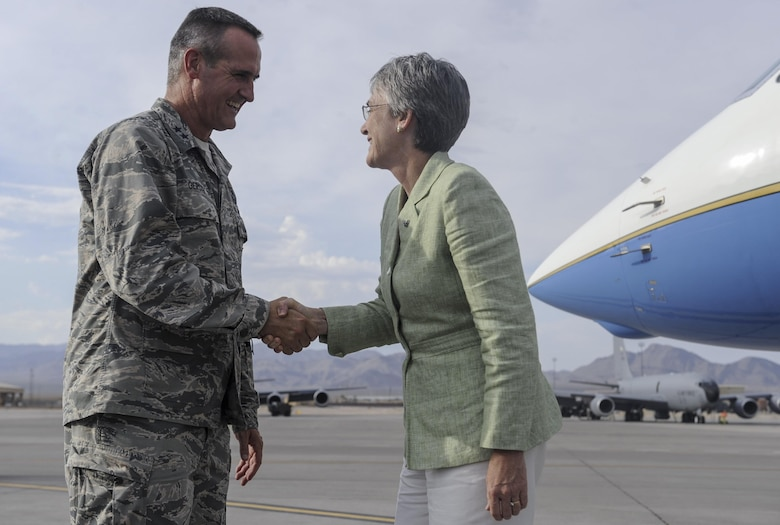 Maj. Gen. Peter Gersten, United States Air Force Warfare Center commander, greets Heather Wilson, Secretary of the Air Force, as she arrives on Nellis Air Force Base, Nevada, July 17, 2017. Wilson discussed her priorities of readiness and innovation during her week in southern Nevada. (U.S. Air Force photo by Senior Airman Kevin Tanenbaum)