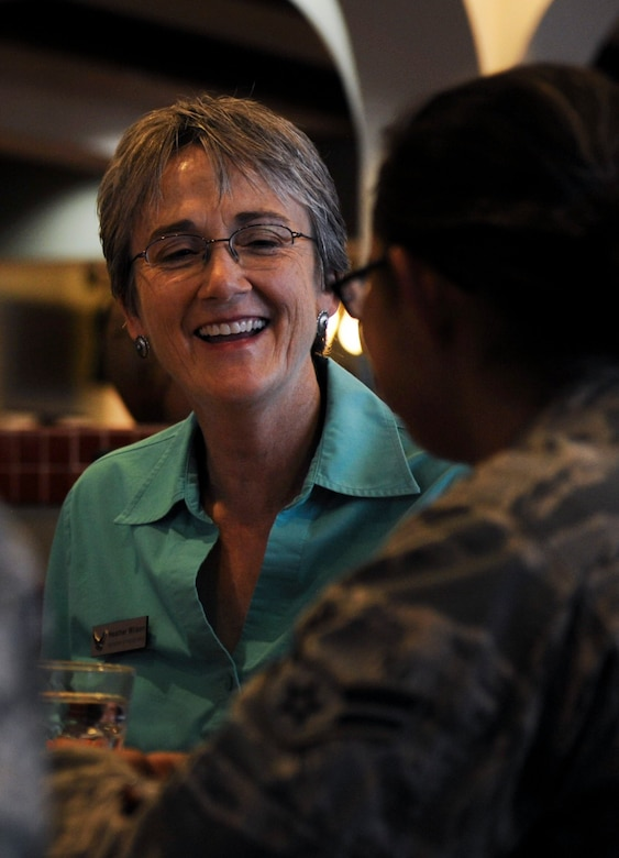 Air Force Secretary Heather Wilson laughs during a lunch with Airmen at the Crosswinds Dining Facility on Nellis Air Force Base, Nevada, July 18, 2017. Wilson was impressed with the skills in which in which Airmen execute the responsibilities the Air Force places on their shoulders. (U.S. Air Force photo by Senior Airman Kevin Tanenbaum)