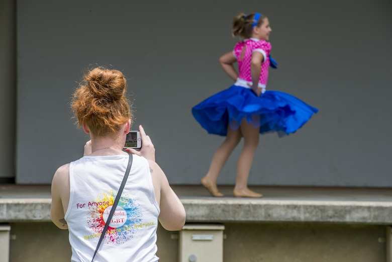 An audience member takes a video of a performance during the Lesbian, Gay, Bisexual and Transgender BBQ Field Day event, June 6, 2017, at Yokota Air Base, Japan. The event had over 150 participants and consisted of activities for families and included performances from various base groups including the Yokota Samurai Taiko drum team. (U.S. Air Force photo by Airman 1st Class Donald Hudson)