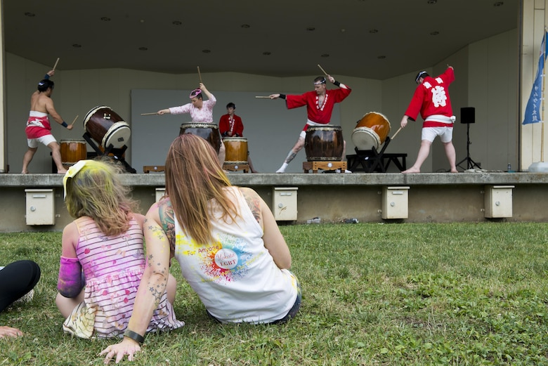 Audience members watch the Yokota Samurai Daiko performance during the Lesbian, Gay, Bisexual and Transgender BBQ Field Day event, June 6, 2017, at Yokota Air Base, Japan. The event had over 150 participants and consisted of activities for families and included performances from various base groups including the Yokota Samurai Daiko and multiple youth dance groups, and a bouncy castle and multi-colored powdered paint for kids to play with. (U.S. Air Force photo by Airman 1st Class Donald Hudson)