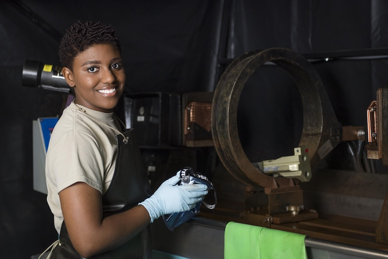 Senior Airman Kayla Hayes, 374th Maintenance Squadron non-destructive inspection journeyman, prepares for work identifying structural imperfections in aircraft machinery, July 24, 2017, at Yokota Air Base, Japan. Hayes is an active part of Yokota's community through taking part in activities such as the head of logistics for Martin Luther King Day, wing LGBT Pride Observance Committee chairman, Honor Guard and teaching diversity to students across the world through the University of Maryland University College with her wife Master Sgt. Candice Hayes, 374th Logistics Readiness Squadron cargo movement section chief. (U.S. Air Force photo by Airman 1st Class Donald Hudson)