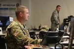 Lt. Col. Larry Boggs, plans and integrations officer for the West Virginia National Guard, monitors operations for the 2017 National Jamboree July 21, 2017, at the Glen Jean Armory in Glen Jean, W. Va. Boggs, who is also a scoutmaster, was a prime planner for the event which draws 30,000 Scouts.