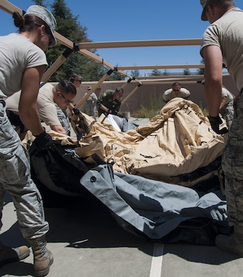 Members of the 349th Aeromedical Staging Squadron put together an En-Route Patient Staging Facility as part of a unit evaluation inspection for Patriot Wyvern at Travis Air Force Base, Calif., July 22, 2017. The 349th ASTS members had one hour to set up the ERPSF and communications. They accomplished their task in 35 minutes. (U.S. Air Force photo by Staff Sgt. Daniel Phelps)