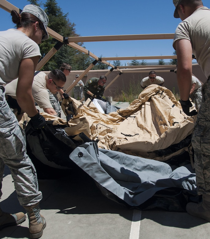 Members of the 349th Aeromedical Staging Squadron put together an En-Route Patient Staging Facility as part of a unit evaluation inspection for Patriot Wyvern at Travis Air Force Base, Cali., on July 22, 2017. The 349th ASTS members had one hour to set up the ERPSF and communications. They accomplished their task in less than 30 minutes. (U.S. Air Force photo by Staff Sgt. Daniel Phelps)