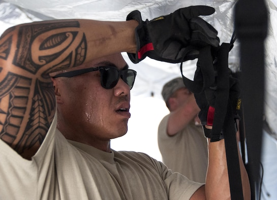 Tech. Sgt. Peter Sampayan, 349th Aeromedical Staging Squadron logistics technician, helps put together an En-Route Patient Staging Facility as part of a unit evaluation inspection for Patriot Wyvern at Travis Air Force Base, Calif., July 22, 2017. The 349th ASTS members had one hour to set up the ERPSF and set up communicatios. They accomplished their task in 35 minutes. (U.S. Air Force photo by Staff Sgt. Daniel Phelps)