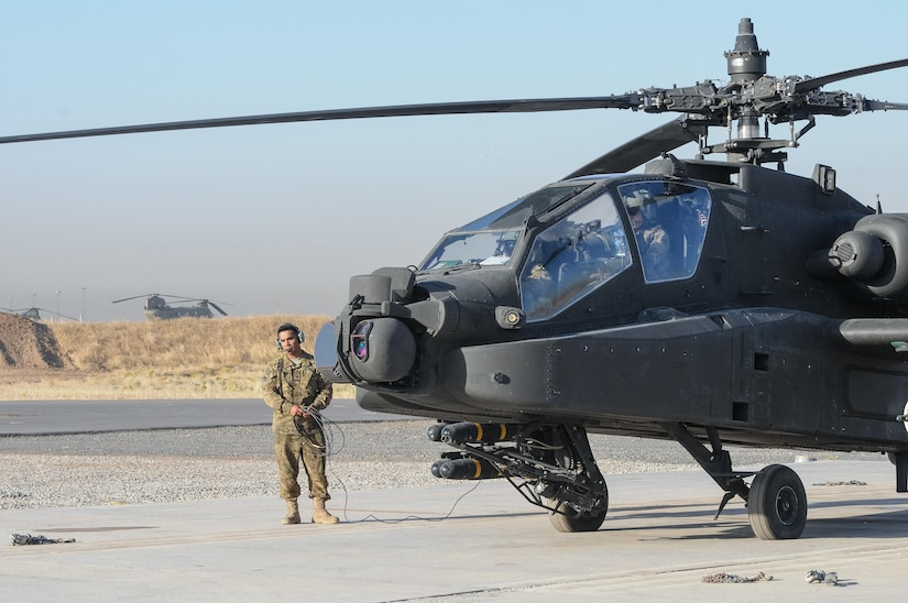 ERBIL, Iraq – Spc. Richard Pena, a crew chief assigned to C Troop, 4th Squadron, 6th Cavalry Regiment, Task Force Saber, conducts pre-flight inspections of an AH-64E Apache helicopter at Erbil, Iraq, July 11, 2017. The AH-64E Apache provides reconnaissance and attack capability in the fight against ISIS for Combined Joint Task Force – Operation Inherent Resolve. CJTF-OIR is the Coalition to defeat ISIS in Iraq and Syria (U.S. Army photo by Capt. Stephen James)