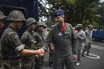 U.S. Air Force Col. David Shoemaker, 8th Fighter Wing commander, greets Republic of Korea Air Force personnel before a joint hazardous material training scenario at Kunsan Air Base, ROK, July 21, 2017. The 8th Civil Engineer Squadron readiness and emergency management flight hosted the training scenario, which educated participants on HAZMAT response equipment and operations. (U.S. Air Force photo by Senior Airman Michael Hunsaker/ Released)