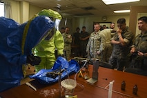 Republic of Korea Air Force members watch as 8th Civil Engineer Squadron readiness and emergency management flight Airmen perform tests to identify an unknown substance in a training scenario at Kunsan Air Base, Republic of Korea, July 21, 2017. The training gave members a better understanding of hazardous material response equipment and operations. (U.S. Air Force photo by Senior Airman Michael Hunsaker/ Released)