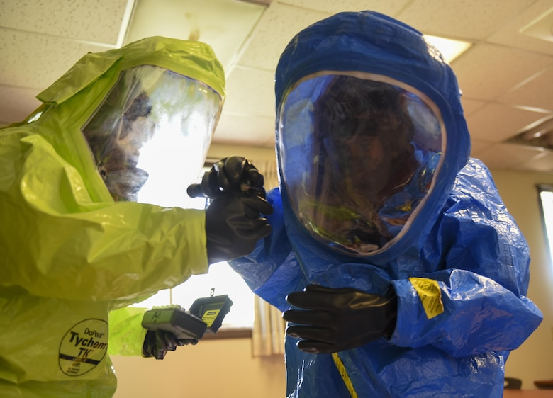 U.S. Air Force Senior Airman Elissa Humphery, 8th Civil Engineer Squadron emergency management journeyman, right, and Staff Sgt. Adam Ruiz, 8th Medical Operations Squadron industrial hygiene noncommissioned officer in charge, fill a vile with an unknown chemical during a joint hazardous material training scenario at Kunsan Air Base, Republic of Korea, July 21, 2017. The 8th CES hosted the training to enhance their ability to operate with their ROKAF counterparts. (U.S. Air Force photo by Senior Airman Michael Hunsaker/ Released)