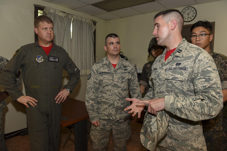 U.S. Air Force Capt. Alexander Graboski, 8th Civil Engineer Squadron readiness and emergency management flight commander, briefs Col. David Shoemaker, 8th Fighter Wing commander, during a joint hazardous material training scenario at Kunsan Air Base, Republic of Korea, July 21, 2017. The 8th CES hosted  joint HAZMAT training to enhance interoperability with their ROKAF counterparts. (U.S. Air Force photo by Senior Airman Michael Hunsaker/ Released)