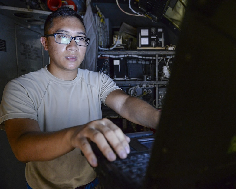 U.S. Air Force Senior Airman Tony Nguyen, guidance and control journeyman assigned to the 340th Expeditionary Aircraft Maintenance Unit, reviews a technical order before replacing a power control relay on a KC-135 Stratotanker at Al Udeid, Air Base, Qatar, July 7, 2017. The members of the 340th and 22nd EAMUs face minute-by-minute challenges in the sweltering heat on the runway as they work to keep a fleet of KC-135 Stratotankers ready to fly. (U.S. Air National Guard photo by Tech. Sgt. Bradly A. Schneider/Released)
