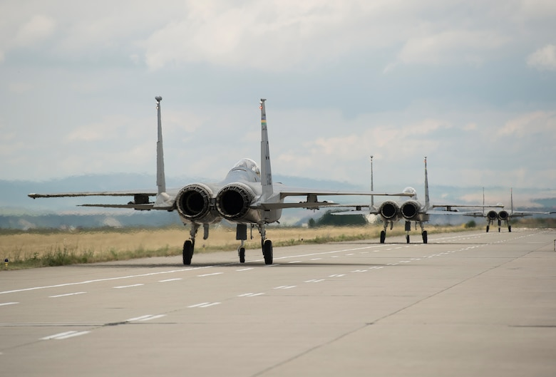 Three F-15C Eagle fighter aircraft from the 159th Expeditionary Fighter Squadron taxi prior to takeoff from Campia Turzii, Romania, July 13, 2017. The squadron is in Romania in support of Operation Atlantic Resolve, an ongoing operation meant to enhance the security of Europe and bolster partnership between NATO allies. (U.S. Air Force photo by Tech. Sgt. Chad Warren)