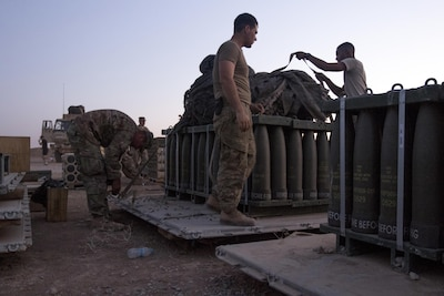 Paratroopers, with Charlie Battery, 2nd Battalion, 319th Airborne Field Artillery Regiment, 82nd Airborne Division, work late into the evening preparing munitions for movement at Forward Operating Base Shalalot, Iraq, July 6, 2017. The fuel, ammunition and life support essentials needed to sustain the fight against ISIS in the U.S. Army Central Command area of operations are provided by U.S. Army Reserve Soldiers from the 316th Sustainment Command (Expeditionary), acting as the 1st Sustainment Command (Theater) Operational Command Post, in Camp Arifjan, Kuwait. The 1st TSC has provided approximately 22 million rounds of ammunition, nearly 3 million gallons of fuel, over 1,000 vehicles,  nearly 400 million gallons of water and more than 13,000 weapons. (U.S. Army Photo by Sgt. Christopher Bigelow)