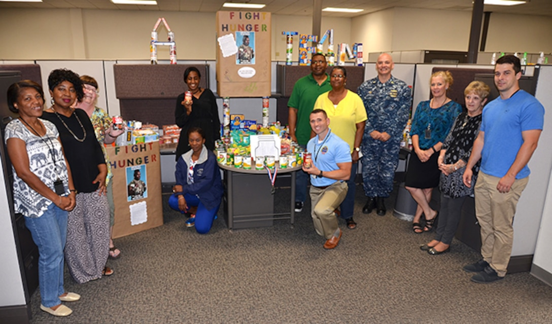 The Food Bank Team, made up of employees from DLA Aviation Supplier Operations and Planning Process Directorates, poses with their display June 7, 2017.  The temporary team, formed to build morale and comradery, collected almost 600 items for Downtown Churches United in Petersburg, Virginia.