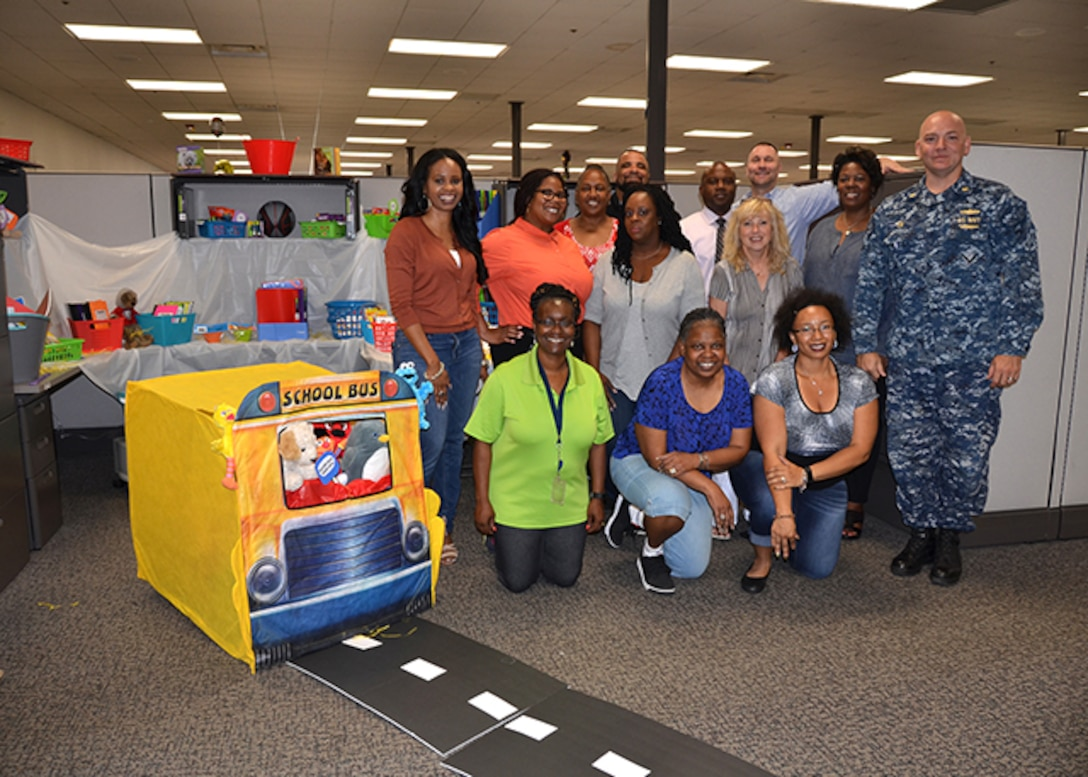 The School Team, made up of employees from DLA Aviation Supplier Operations and Planning Process Directorates, poses with their display June 7, 2017. The temporary team, formed to build morale and comradery, collected supplies for Baker Elementary School in Henrico County, Virginia.  The school closed after a fire last year and will reopen this fall.