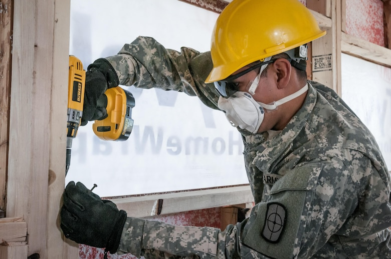 U.S. Army Reserve Spc. Alex Lopez, a carpentry and masonry specialist of the 994th Engineer Company out of Denver, Colorado, assists in the construction of a staff-member bath house at the YMCA of the Rockies - Snow Mountain Ranch, Granby, Colorado, July 20, 2017. (U.S. Army Reserve photo by Spc. Ce Shi, 222nd Broadcast Public Affairs Detachment)