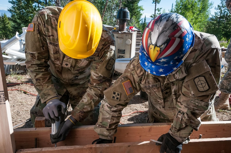 U.S. Army Reserve Spc. Alexander Wise, left, and U.S. Army Reserve Spc. Jesus Javalera, right, both interior electricians with the 409th Engineer Company out of Fort Collins, Colorado, construct an archery storage shed at the YMCA of the Rockies - Snow Mountain Ranch, Granby, Colorado, July 20, 2017. (U.S. Army Reserve photo by Spc. Ce Shi, 222nd Broadcast Public Affairs Detachment)