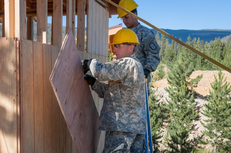 U.S. Army Reserve Spc. Gage Dean, a carpentry and masonry specialist, left, and U.S. Army Reserve Pfc. Edgar Briones, a plumber, at right, from the 994th Engineer Company out of Denver, Colorado, install siding during the construction of a large storage shed at the YMCA of the Rockies - Snow Mountain Ranch, in Granby, Colorado, July 20, 2017. (U.S. Army Reserve photo by Spc. Miguel Alvarez, 354th Mobile Public Affairs Detachment)