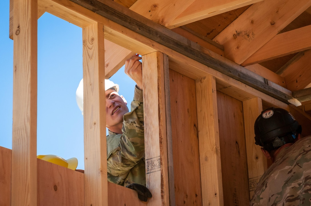 U.S. Army Reserve Pfc. Dylan Burgess, a carpentry and masonry specialist and site supervisor with the 409th Engineer Company out of Fort Collins, Colorado, secures construction efforts during the construction of a large storage shed at the YMCA of the Rockies - Snow Mountain Ranch, in Granby, Colorado, July 20, 2017. (U.S. Army Reserve photo by Spc. Ce Shi, 222nd Broadcast Public Affairs Detachment)
