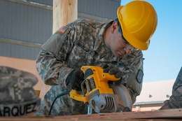 U.S. Army Reserve Spc. David Marquez, a plumber with the 994th Engineer Company out of Denver, Colorado, works with the team to construct a large storage shed at the YMCA of the Rockies - Snow Mountain Ranch, in Granby, Colorado, July 20, 2017. (U.S. Army Reserve photo by Spc. Miguel Alvarez, 354th Mobile Public Affairs Detachment)