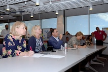 Lt. Gen. Michelle Johnson, the superintendent of the Air Force Academy (right), and Lance Bolton, president of Pikes Peak Community College, take notes during one of four skits presented by IT experts and high school and college students, July 20, 2017, at the CyberWorx Design Sprint at the U.S. Air Force Academy. (U.S. Air Force photo/Darcie Ibidapo