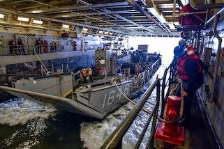 PACIFIC OCEAN - (Jul. 23, 2017) -- Sailors secure lines from a Landing Craft Unit (LCU) from Beachmaster Unit 1 aboard the amphibious transport dock ship USS Somerset (LPD 25) in support of UNITAS LVIII. UNITAS is an annual, multi-national exercise that focuses on strengthening our existing regional partnerships and encourages establishing new relationships through the exchange of maritime mission-focused knowledge and expertise during multinational training operations.  (U.S. Navy Photo by Mass Communication Specialist 2nd Class Jacob I. Allison/RELEASED)