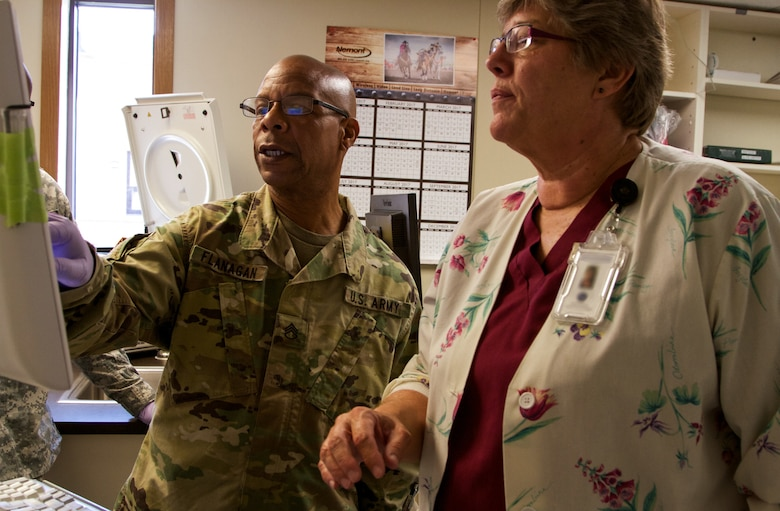 Staff Sgt. Phillip Flangan, a combat medic specialist with the 7239th Medical Support Unit, Chattanooga, Tennessee, works with Myrna Kampel, lead medical technologist at the Verne E. Gibbs Clinic at Poplar, Montana, as part of the Fort Peck Innovative Readiness Training, July 17, 2017. During the two-week-long mission, Army Reserve Soldiers will collaborate with the clinic staff providing medical and dental care to an estimated population of over 8,000 residents. (U.S. Army Reserve photo by Spc. Claudia Rocha 345th Public Affairs Detachment)