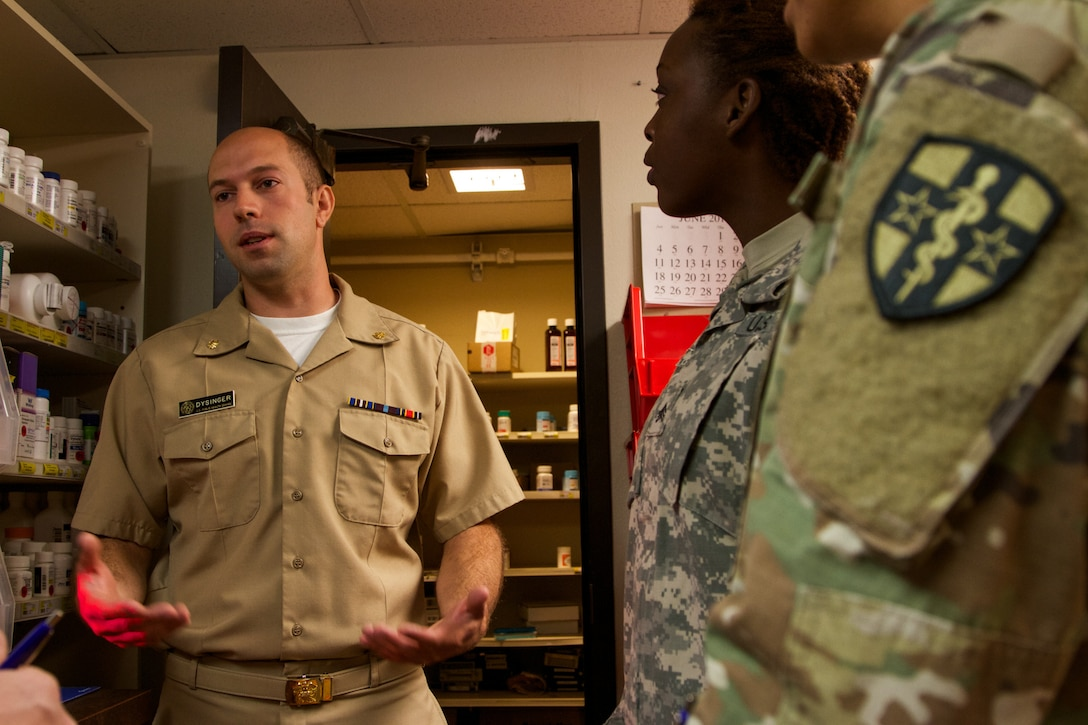 US Public Health Service Lt. Cmdr. Cole Dysinger, a pharmacist at the at the Verne E. Gibbs Clinic at Poplar, Montana, informs the incoming Soldiers of the 7239th Medical Support Unit, Chattanooga, Tennessee, about the facilities and procedures as they begin their Fort Peck Innovative Readiness Training July 17, 2017. During the two-week-long mission, medical and dental care will be provided to an estimated population of over 8,000 residents.(U.S. Army Reserve photo by Spc. Claudia Rocha 345th Public Affairs Detachment)