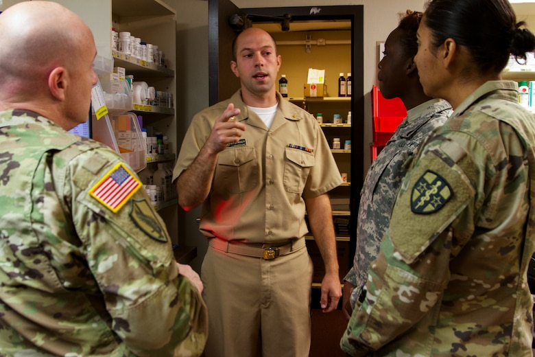 US Public Health Service Lt. Cmdr. Cole Dysinger, a pharmacist at the Verne E. Gibbs Clinic at Poplar, Montana clinic, informs the incoming Soldiers of the 7239th Medical Support Unit, Chattanooga, Tennessee, about the facilities and procedures as they begin their Fort Peck Innovative Readiness Training, July 17, 2017. During the two-week-long mission, medical and dental care will be provided to an estimated population of over 8,000 residents.(U.S. Army Reserve photo by Spc. Claudia Rocha 345th Public Affairs Detachment)