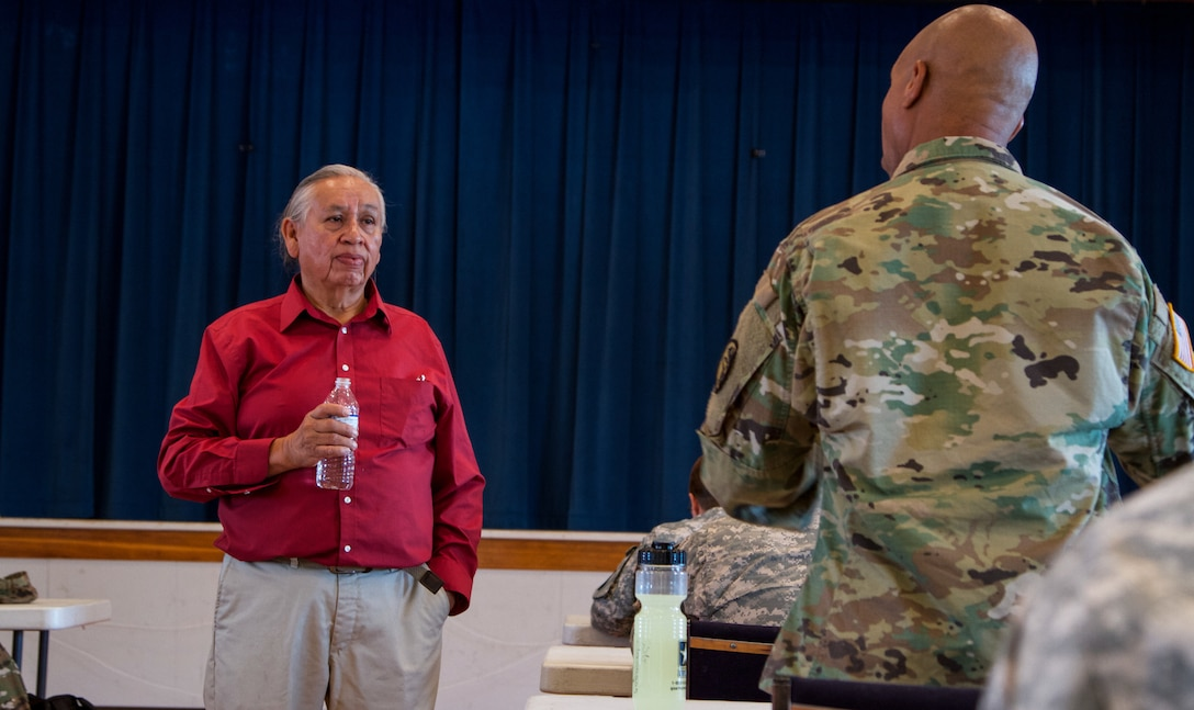 Albert Foote Sr., an elder Native American from Poplar, Montana, invited by the Fort Peck Indian Health Service to give a cultural briefing and welcome Soldiers of the 7239th Medical Support Unit, Chattanooga, Tennessee. He briefed them about the local residents' culture and traditions as they begin their Innovative Readiness Training at the Verne E. Gibbs Clinic at Poplar, July 17, 2017. The mission is a civil-military program that builds a mutually beneficial partnership between U.S. communities and the Department of Defense to meet training and readiness requirements for Active, Guard and Reserve service members while addressing public and civil society needs. (U.S. Army Reserve photo by Spc. Claudia Rocha 345th Public Affairs Detachment)