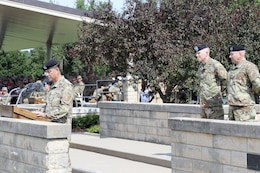 Col. Chris Black, 1st Combat Aviation Brigade, 1st Infantry Division, commander, speaks in a Change of Command ceremony at Cavalry Parade Field on Fort Riley July 7. The ceremony was to congratulate Col. John M. Cyrulik, outgoing commander, on a job well done and to welcome Black as he takes over.