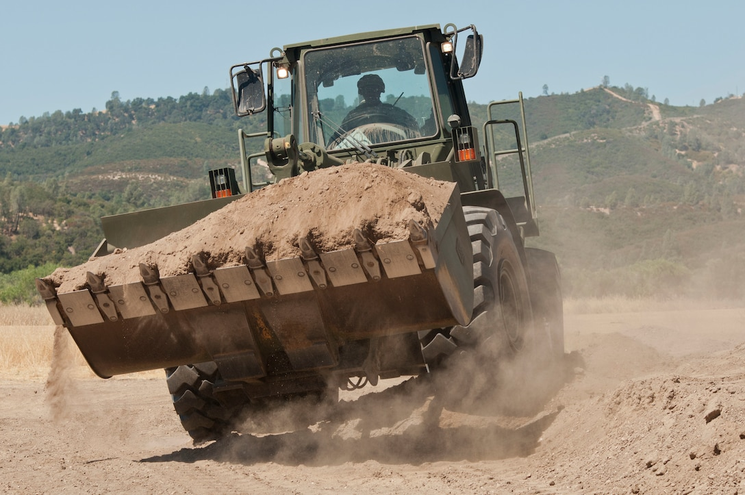 A Reserve Soldier from the the 718th Engineer Company out of Fort Benning, Ga. operates a front-end loader during Combat Support Training Exercise 91-17-03 at Fort Hunter Liggett, Calif., on July 19, 2017. Nearly 5,400 service members from the U.S. Army Reserve, U.S. Army, Army National Guard, U.S. Navy, and Canadian Armed Forces are training at Fort Hunter Liggett, Calif., as part of the 84th Training Command's CSTX 91-17-03 and ARMEDCOM's Global Medic; this is a unique training opportunity that allows U.S. Army Reserve units to train alongside their multi-component and joint partners as part of the America's Army Reserve evolution into the most lethal Federal Reserve force in the history of the nation. (U.S. Army Reserve photo by Sgt. Thomas Crough, 301st Public Affairs Detachment)