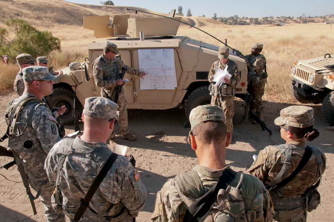 Army Reserve Soldiers from the 949th Transportation Detachment (Movement Control Team) out of Boise, Idaho, listen to a mission brief during Combat Support Training Exercise 91-17-03 at Camp Roberts, Calif., on July 20, 2017. Nearly 5,400 service members from the U.S. Army Reserve, U.S. Army, Army National Guard, U.S. Navy, and Canadian Armed Forces are training at Fort Hunter Liggett, Calif., as part of the 84th Training Command's CSTX 91-17-03 and ARMEDCOM's Global Medic; this is a unique training opportunity that allows U.S. Army Reserve units to train alongside their multi-component and joint partners as part of the America's Army Reserve evolution into the most lethal Federal Reserve force in the history of the nation. (U.S. Army Reserve photo by Sgt. Thomas Crough, 301st Public Affairs Detachment)