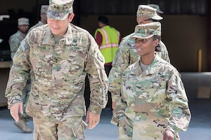 Maj. Gen. Edward Dorman (left), J-4 (logistics), U.S. Central Command, talks with Col. Carmelia Scott-Skillern, commander, 401st Army Field Support Brigade during a tour of an Army Prepositioned Stocks-5 warehouse at Camp Arifjan, Kuwait, July 20. (U.S. Army Photo by Justin Graff, 401st AFSB Public Affairs) (Photo Credit: U.S. Army)