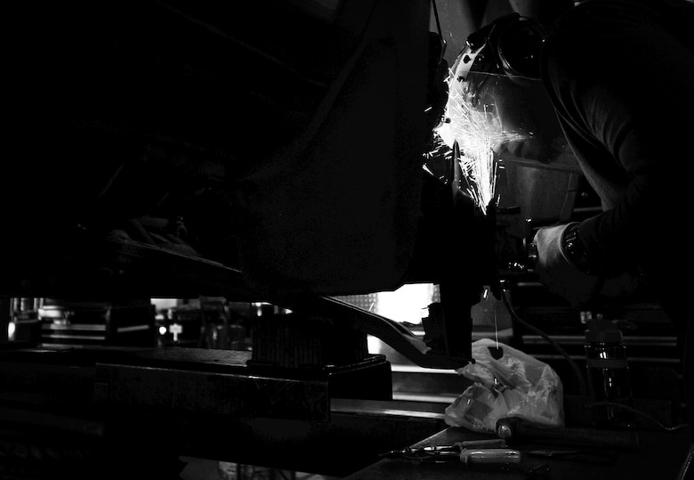 Tech. Sgt. Robert Ivey, 27th Special Operations Civil Engineer Squadron pavement and construction equipment operator, works on his car at the auto hobby shop at Cannon Air Force Base, N.M., Jul. 11, 2017. Airmen visiting the shop are supported with a large array of equipment, some of which are aging. The shop mainly works off hand-me-down equipment from other units and lives off a steady flow of Airmen. (U.S. Air Force photo by Senior Airman Lane T. Plummer)