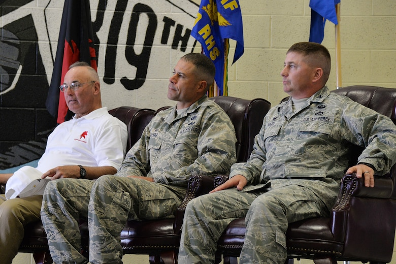 Retired Col. Gary Shick, left, first commander of the 219th RED HORSE Squadron, Col. Jose Rivera, 819th RED HORSE Squadron commander, center, and Col. Rusty Vaira, current 219th RHS commander, sit during the 20th anniversary of the squadrons' activations July 20, 2017, at Malmstrom Air Force Base, Mont. The commanders each shared words with the audience in attendance and asked them to share their stories with one another. (U.S. Air Force photo/Airman 1st Class Daniel Brosam)