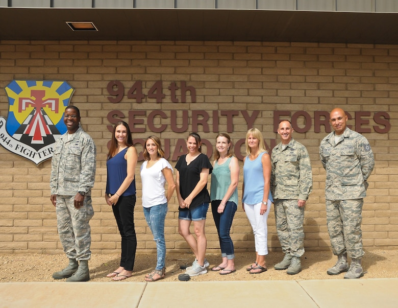 Key spouses from the 944th Security Forces Squadron pose for a photo with Col. Robert Tofil, 944th Fighter Wing vice commander, and Airman and Family Readiness Center staff members July 9 at Luke Air Force Base, Arizona. Key spouses work closely with unit leaders to bring important information to the families and voice their concerns to the unit leaders. (U.S. Air Force photo by Tech. Sgt. Nestor Cruz)