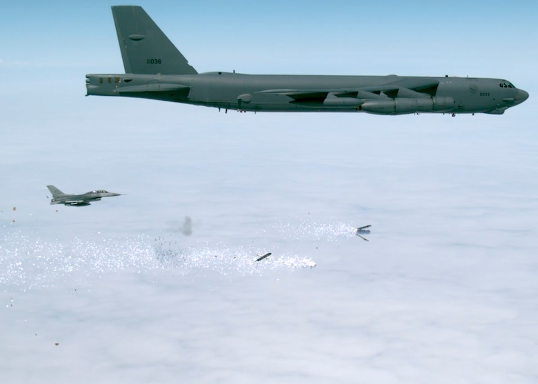 A frame from a video shows the PDU-5/B leaflet bomb activating and dispersing the leaflets. (U.S. Air Force image)