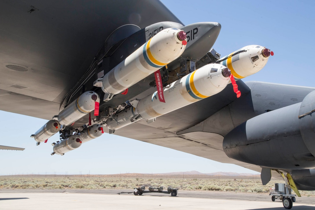 A B-52 Stratofortress assigned to the 419th Flight Test Squadron with eight PDU-5/B leaflet bombs underneath the left wing. The PDU-5/B is a repurposed Cluster Bomb Unit used to release leaflets (paper cut into a specific size). Leaflets are generally dropped during U.S. military psychological operations overseas. When released from the aircraft, a fuse is set to a certain time to tell the bomb to detonate and release the leaflets. (U.S. Air Force photo by Christopher Okula)
